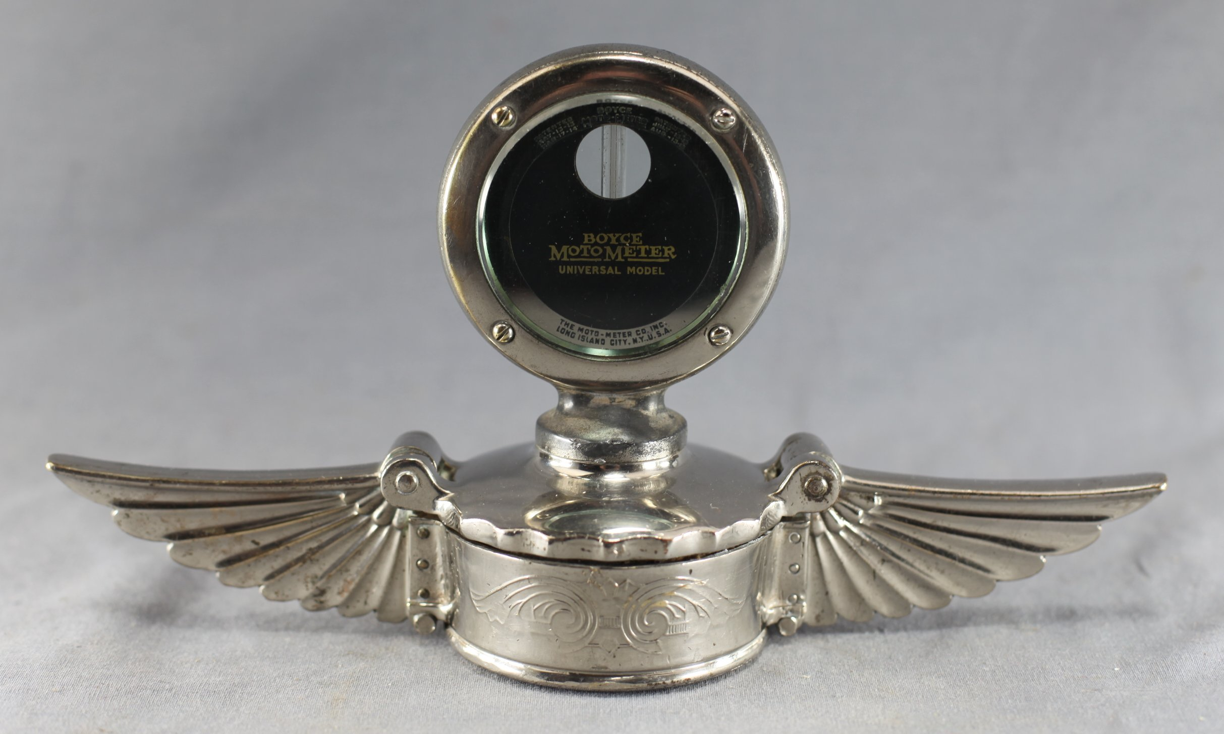 Hinged-Cap Winged Motometer